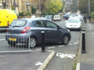Inconsiderate car parking blocks cycle path photo